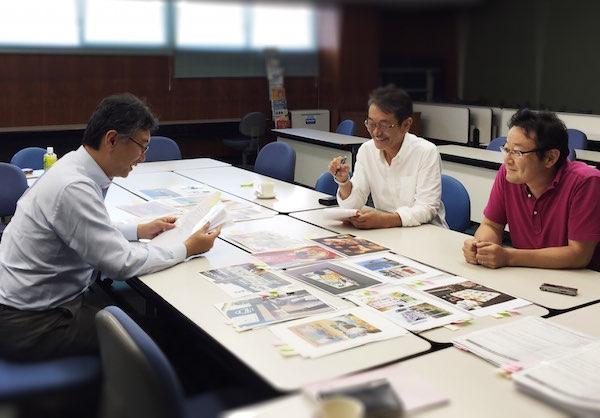 看板大賞審査 笹井編集長(左)と看板のコンサル高橋氏(右)